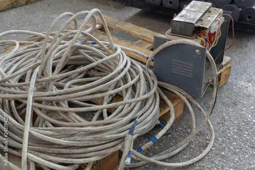 Thick powerful white cable and old transformer welding
