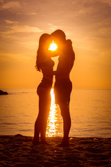 young couple is kissing at the sea