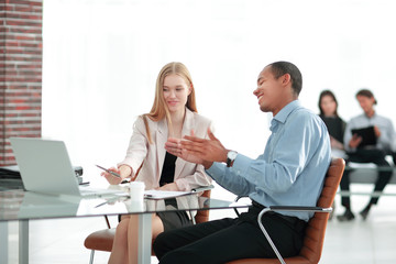 young business colleagues talking behind a Desk