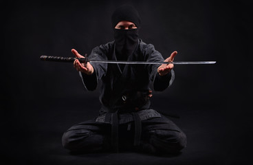 Ninja samurai holds katana in a hands