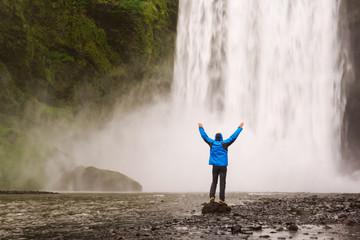 Man near waterfall