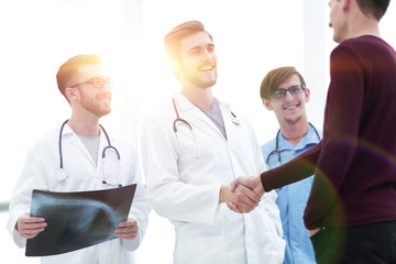 patient shaking hands with doctor.