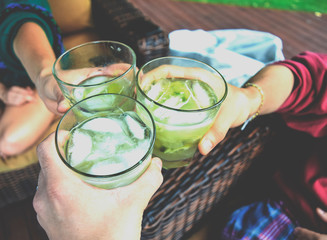 Friends toasting with Brazilian caipirinhas