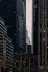 Perspective view to facade fragment of the modern buildings and Empire State building in midtown Manhattan