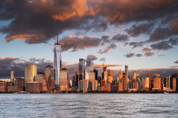 Jersey City, NJ / USA - OCT 24 2018: Lower Manhattan skyline at sunset view from Hudson riverside