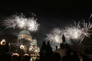 Fireworks explode over the St. Sava temple and Karadjordje's monument during the Orthodox Christian New Year's Day celebrations in Belgrade, Serbia