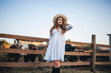 The girl in the white dress on the farm.