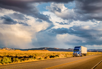 Aluminium Prints American Famous Place Semi trailer truck on highway at sunset