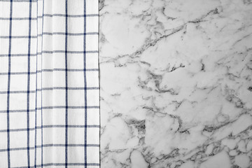 Fabric napkin and space for text on marble background, top view