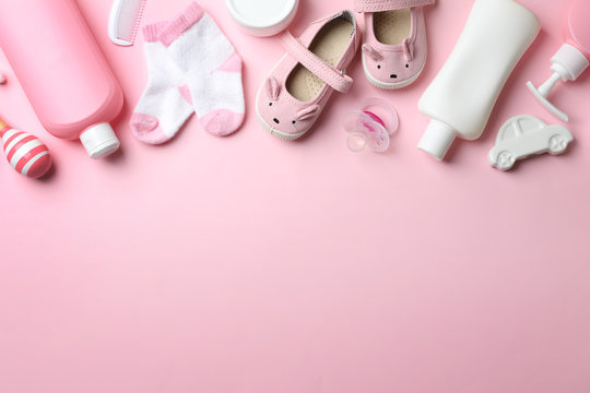Flat lay composition with baby accessories on color background. Space for text