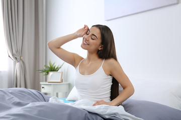 Young woman stretching at home in morning. Bedtime