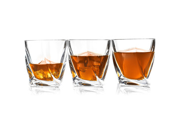 Glasses of scotch whiskey on white background, space for text