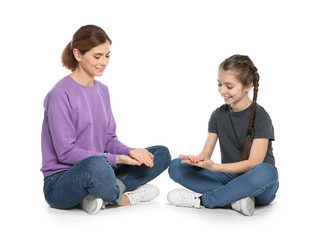 Hearing impaired mother and her child talking with help of sign language on white background