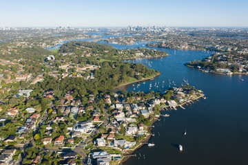 Aerial view of the Parramatta river and the Sydney city skyline to the east.
