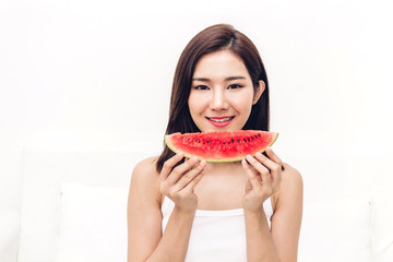 Woman smiling holding and eating slice fresh watermelon on white background.dieting.healthy lifestyle and summer holiday concept