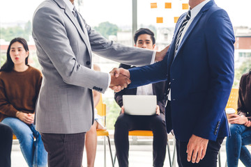 Image two business partners in elegant suit successful handshake  together in modern office.Partnership approval and thanks gesture concept