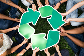 Group of people with a recycling board