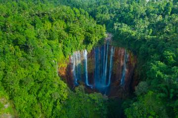 Tumpak Sewu waterfall in the tropical forest