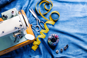 sewing indigo denim jeans with sewing machine, garment industrial concept.