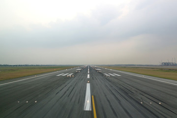 Airport runway in the evening with light system opened, ready for airplane landing or taking off. Seen from the airplane cockpit. Modern aviation concept. Wall mural