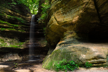 Canyon walls and cascade after the morning Summer rain in St. Louis Canyon.  Starved Rock State Park, Illinois, U.S.A.