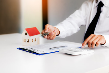 Home agents are sending key to customers signing a contract to buy a new home.