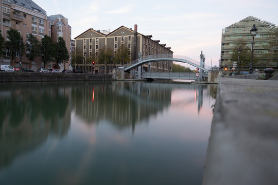 Paris, France - 10 14 2018: Canal Lourcq. The lift bridge of Flanders at sunrise