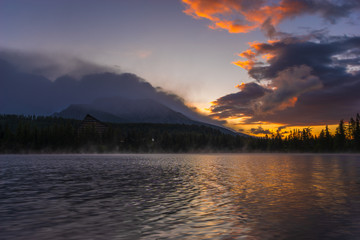 Wall Mural - spectacular sunrise on the mountain lake Strbske Pleso in Slovakia