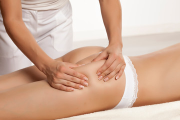 anti-cellulite massage on the legs of young women