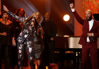 "Singers Common and Adams perform ""Young, Gifted and Black"" during the taping of ""Aretha! A Grammy Celebration For The Queen Of Soul"" at the Shrine Auditorium in Los Angeles"