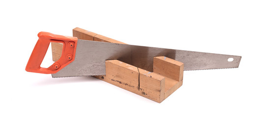 Miter box with a saw