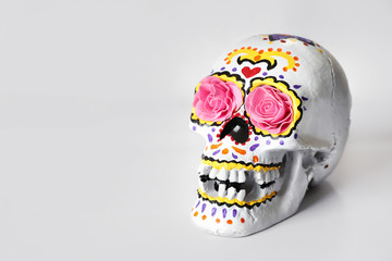 Painted human skull for Mexico's Day of the Dead on white background