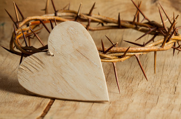 Crown of thorns over brown marble background