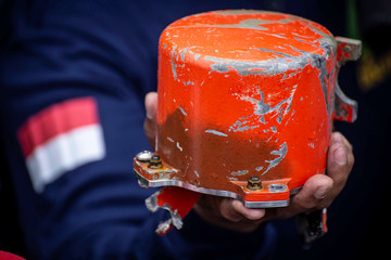 Indonesia's National Transportation Safety Committee (KNKT) officer shows a cockpit voice recorder (CVR) of a Lion Air JT610 that crashed into Tanjung Karawang sea, on the deck of Indonesia's Navy ship KRI Spica-934 at Karawang sea in West Java