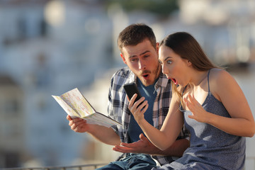 Amazed tourists finding online offers on vacation