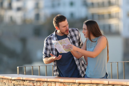 Couple arguing about travel destination on vacation