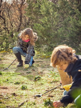 Boy and girl picking up garbage from ground