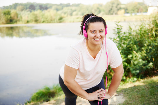 Portrait of smiling woman exercising outdoors