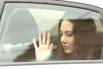 Sad woman inside a car during a roadtrip