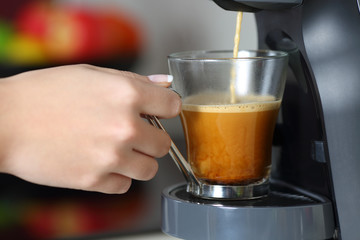 Woman hand using a coffee maker