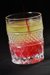 crystal Glass with efervescent tablet in water with raspberry syrup