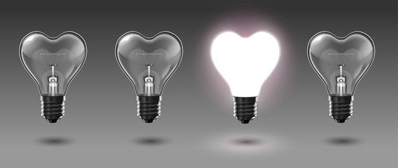 Four transparent heart-shaped bulbs, one of which glows with white light. Highly realistic illustration.