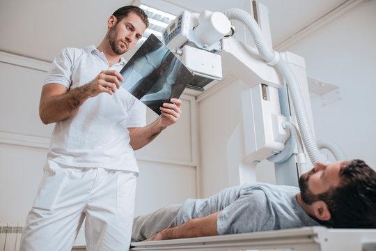 Doctor Examining X-ray Films