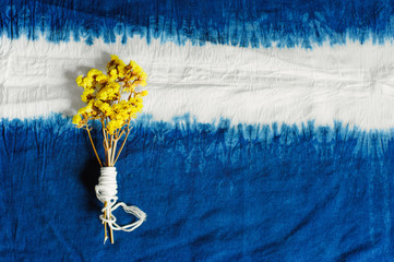 blue Indigo dyed cotton decorate with yellow flowers