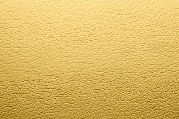Yellow skin texture.Beige leather background.