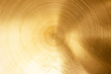 Abstract Gold polished metal brushed background or Shiny yellow leaf gold steel texture. Brushed...