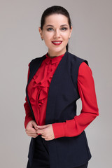 Portrait of a beautiful girl in bright business clothes isolated on a light background