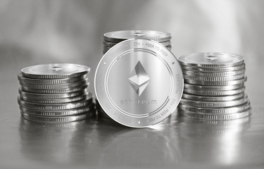 Ethereum (ETH) digital crypto currency. Stack of silver coins. Cyber money.