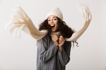 Happy young woman wearing winter clothes Wall mural