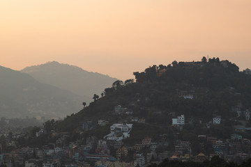 Sunset view of building and mountains during sunset at Kathmandu, Nepal.
